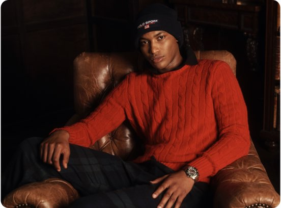 Man in red cable-knit crewneck sweater